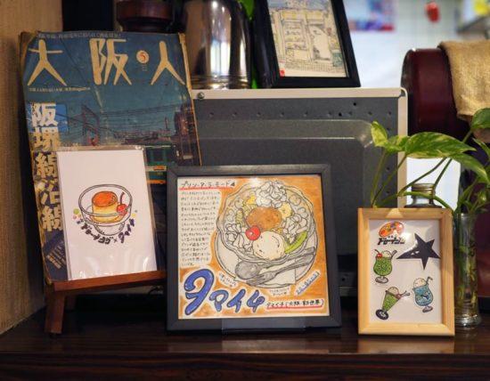 喫茶タマイチに飾られた喫茶ドローイングの絵